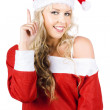 Happy Female Santa Clause Pointing To Copy Space - Stock Photo