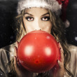 Young Christmas Girl Blowing Up Party Balloon — Stock Photo