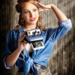 Young Retro Woman Holding Instant Camera - Stock Photo