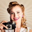 Young Smiling Vintage Girl Taking Photo - Stock Photo