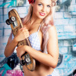 Photo: Portrait Of Young Grunge WomOn Graffiti Wall