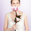Young romantic woman with lotus flowers — Stock Photo