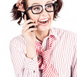 Laughing nerdy woman on a smartphone - Stock Photo