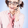 Student on a mobile call with speech bubbles - Stock Photo