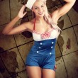 Sailor Pinup Girl On Vintage Travel Map Background — Stock Photo