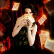 Foto de Stock  : Tarot MagiciHolding Magic Fire Cards Of Fate