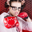 Businesswoman Boxing The Competition With Strategy - Stock Photo