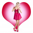 Stock Photo: Cute Pinup Woman On Love Heart Symbol Background