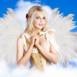 Stock Photo: Cupid Angel Of Love Flying High With Fairy Wings
