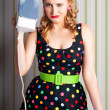 Funny 50s Pinup Girl Holding Steaming Hot Iron - Stockfoto