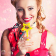American Pinup Flight Hostess Giving Star Service - Stockfoto