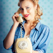 Sixties Woman Holding Vintage Telephone Handset - Stockfoto