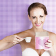 Royalty-Free Stock Photo: Retro Housewife Holding Laundry Washing Powder