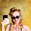 Happy Young Pin-Up Woman Showing Travel Picture - Stockfoto