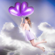Stock Photo: Cute Retro Pinup Girl Holding Heart Shaped Balloon