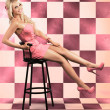 American Culture Pin Up Girl Inside 60s Retro Diner - Stock Photo