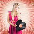 Smiling DJ Woman In Love With Retro Music - Stockfoto