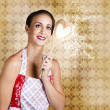 Smiling Female Cook Baking Cake With Sweet Love - Stockfoto