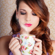 Cute Brunette Woman Drinking Hot Coffee Indoors - Foto Stock