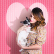 Young Loving Woman Holding Cute Small Pet Dog - Stockfoto