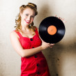 Rockabilly Music Girl Holding Vinyl Record Lp - Stock Photo