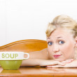 Retro waiter with soup bowl at restaurant counter — Stock Photo #21651369