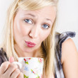 Beautiful woman drinking cup of tea with tea bag — Stock Photo