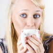 Candid portrait of woman enjoying hot beverage — Stock Photo