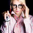 Intelligent female computer geek coding with mouse - Stock Photo