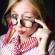 Secretive Nerd Misleading With A Wink Of Deceit - Stock Photo