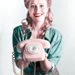 Royalty-Free Stock Photo: Contact Us By Telephone Said A Vintage Pinup Woman