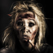 Stock Photo: Evil Dead Female Zombie With Monster Headache
