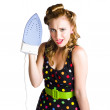 Stock Photo: Cleaning lady with iron