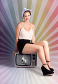 Pinup Housewife Sitting On Vintage Television Set — Stock Photo