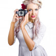 Woman using retro film camera - Stock Photo