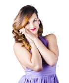 Beautiful woman in purple dress — Stock Photo