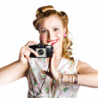 Smiling pinup woman with retro camera — Foto Stock