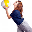 Woman Throwing Beach Ball On White Background - Stock Photo
