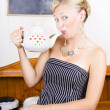 Stock fotografie: Girl In Cafe Serving Hot Coffee With Heart Teapot