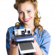 Woman holding instant camera - Stock Photo