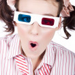 amazed woman watching 3d movie in glasses — Stock Photo