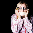 Fearful business nerd silenced with mouth tape - Stock Photo