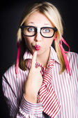 Quiet female dork keeping secret with lips sealed — Stock Photo