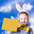 Stock Photo: Cute Boy Announcing Happy Easter Message