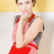 Royalty-Free Stock Photo: Portrait of a thinking cook on kitchen background