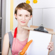 Woman pointing to healthy eating shopping list — Stock Photo