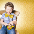 Young boy unwrapping easter egg present - Stock Photo