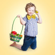 Sweet little child holding easter egg basket — Stok fotoğraf
