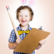 Lovable easter child holding clipboard and pencil — Stock Photo