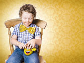 Young boy unwrapping easter egg present — Stock Photo